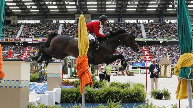 Japan's Hayashi riding Loretto Classic competes in the jumping first competition during the World Equestrian Games in Caen