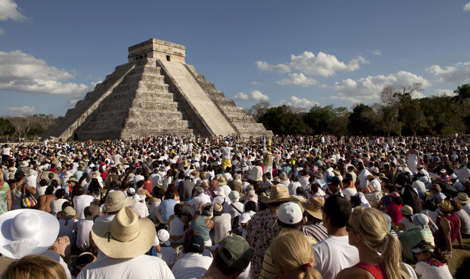 People look at the pyramid of Chichen Itza in the southern Mexican state of Yucatan