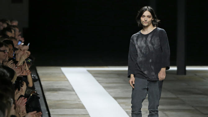 Belgian-born designer Olivier Theyskens appears on the runway at the conclusion of the Theyskens Theory Fall 2013 runway show during Fashion Week in New York, Monday, Feb. 11, 2013.  (AP Photo/Kathy Willens)