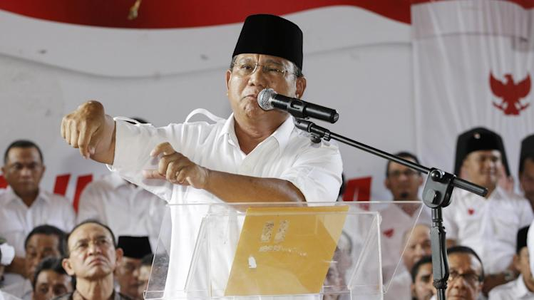 Indonesian presidential candidate Prabowo Subianto gestures during a press conference in Jakarta, Indonesia, Tuesday, July 22, 2014. Nearly complete results in Indonesia's presidential elections showed Jakarta governor Widodo leading with 52 percent of the vote. (AP Photo/Achmad Ibrahim)