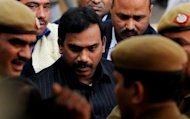 India's former telecoms minister A. Raja (centre) is escorted by police to a New Delhi courthouse in February 2011. Raja, who faces trial over a massive corruption case involving mobile telephone licences, was granted bail after 15 months in prison