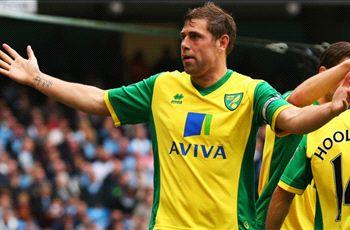 Wigan snaps up Norwich striker Holt