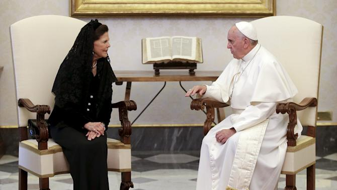 Pope Francis talks with Sweden's Queen Silvia during a meeting at the Vatican
