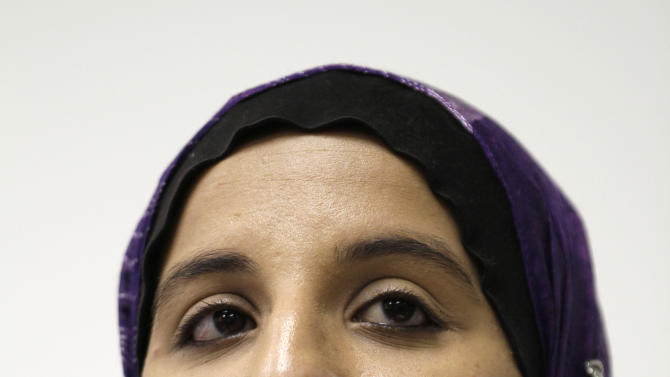 Hani Khan, a former stockroom worker for Abercrombie & Fitch Co. who was fired for refusing to remove her Muslim headscarf, listens to a question during a news conference in San Francisco, Monday, June 27, 2011.  Khan is suing the clothing retailer in federal court, saying she was illegally fired after refusing to remove her hijab.  (AP Photo/Eric Risberg)