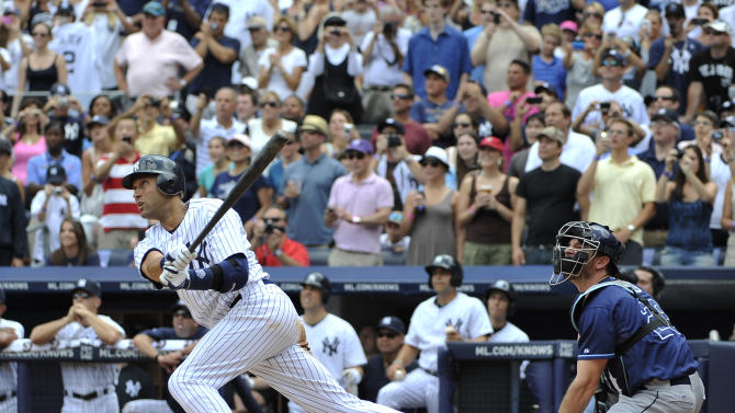 FILE - In this July 9, 2011 file photo, New York Yankees' Derek Jeter hits a solo home run for his 3,000th career hit off of Tampa Bay Rays starting pitcher David Price in the third inning of a baseball game at Yankee Stadium in New York. Jeter says he will retire after this season. Jeter posted a long letter on his Facebook account Wednesday, Feb. 12, 2014, saying the 2014 will be his last year playing professional baseball. (AP Photo/Kathy Kmonicek, File)