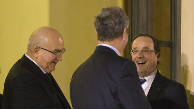 Member of France's Constitutional Council Hubert Haenel, left, Constitutional Council President Jean-Louis Debre, center, bid farewell to French President Francois Hollande, after a New Years speech at the Elysee Palace in Paris, Monday, Jan. 7, 2013. (AP Photo/Michel Euler)