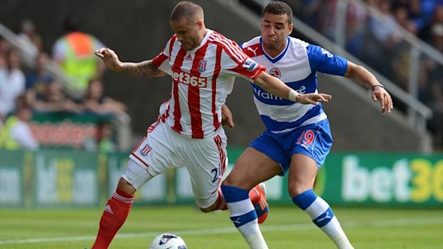 Stoke City's Michael Kightly (left) in action (PA Photos)