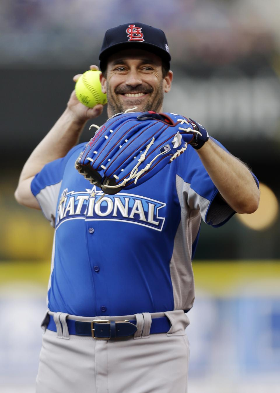 Actor Jon Hamm warms up before the MLB All-Star celebrity softball game, Sunday, July 8, 2012, in Kansas City, Mo. (AP Photo/Jeff Roberson)