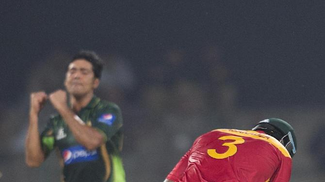 Pakistan's bowler Mohammad Sami  celebrates dismissal of Hamilton Masakadza of Zimbabwe at the Gaddafi stadium in Lahore, Pakistan, Friday, May 22, 2015. Zimbabwe is the first test-playing team to visit this country since gunmen attacked the Sri Lanka team outside this venue in 2009, canceling all major tours to Pakistan until now. (AP Photo/B.K. Bangash)