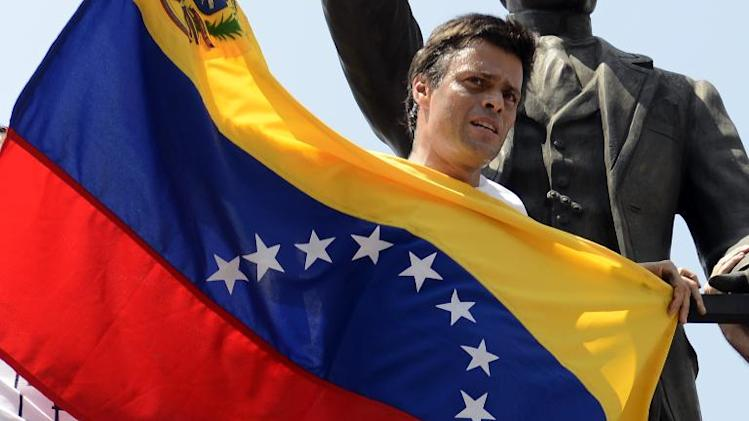 Leopoldo Lopez, an ardent opponent of Venezuela's socialist government with a national flag in Caracas before turning himself in to authorities, on February 18, 2014