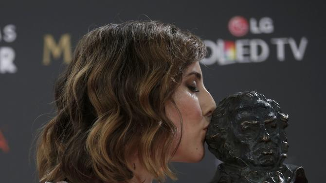 Actress de Molina, who won the Best Leading Actress award, kisses her trophy during the Spanish Film Academy's Goya Awards ceremony in Madrid