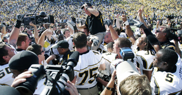 FILE - In this Sept. 1, 2007, file photo, Appalachian State coach Jerry Moore is carried off the field at Michigan Stadium by his players after they upset No. 5 Michigan 34-32 in an NCAA college football game in Ann Arbor, Mich. For the first time a ranked major college team had lost to a team from the lower tier of Division I. But as Appalachian State reminded us all a few years back, you never know when a classic is about to break out. (AP Photo/Duane Burleson, File)