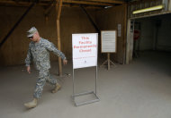 A U.S. Army soldier walks past a sign outside a base exchange after its closure at Camp Victory Base Complex that is set to close in Baghdad, Iraq, Saturday, Oct. 15, 2011. The U.S. has promised to withdraw from Iraq by the end of the year as required by a 2008 security agreement between Washington and Baghdad. Some 41,000 U.S. troops are scheduled to clear out along with their equipment. It's still unclear if the U.S. military will keep several thousand troops in Iraq as leaders weigh whether staunch political opposition in both nations is worth the risk. The uncertainty has been a logistical nightmare for American commanders, who could be asked at the last minute to keep some equipment and manpower back but for now must push ahead in case the withdrawal plan stands. (AP Photo/Khalid Mohammed)