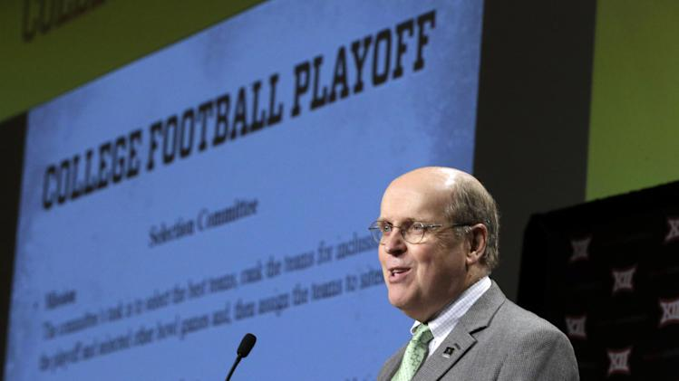 College Football Playoff executive director Bill Hancock speaks to the media at the Big 12 Conference NCAA college football media days in Dallas, Tuesday, July 22, 2014. (AP Photo)