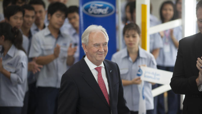 Ford Motor Company executive John Fleming, Executive Vice President for Global Manufacturing and Labor Affairs, smiles as he is introduced during a ceremony Friday, Aug. 31, 2012, at the Ford Motor Company factory in Rayong, Thailand.  Fleming was there to announce the 350 millionth globally produced Ford Focus.  (AP Photo/str)