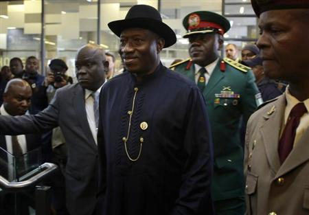 Nigeria's President Goodluck Jonathan arrives for the service for former South African President Nelson Mandela