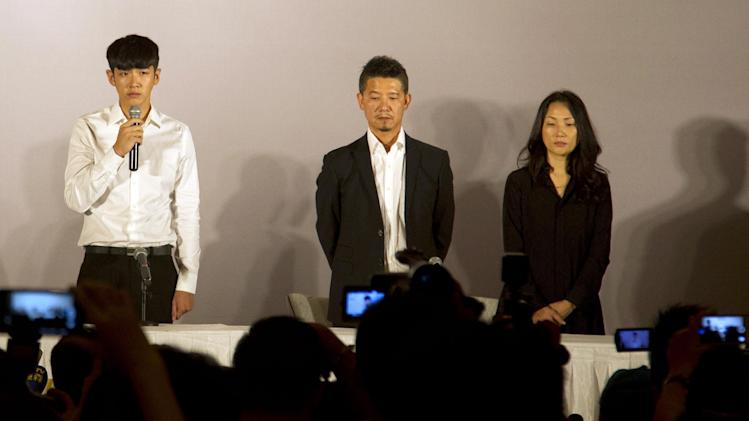 Kai Ko, left, speaks next to his father Ko Yao-tsung and his mother during a press conference held after his release from detention in Beijing Friday, Aug. 29, 2014. Ko, a Taiwanese actor arrested on drug charges along with the son of Hong Kong film star Jackie Chan, was released Friday after two weeks in detention, amid a broad anti-drug crackdown in China's capital that has ensnared several celebrities. (AP Photo/Peng Peng)