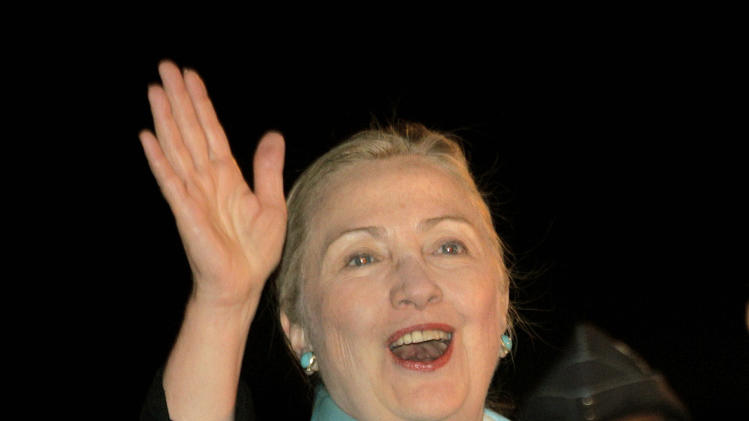 U.S. Secretary of State Hillary Clinton waves to media as she arrives at the Indira Gandhi International airport, in New Delhi, India, Monday, July 18, 2011. Clinton is in India for security and counterterrorism talks as the two countries try to broaden their relationship.  (AP Photo/Manish Swarup)