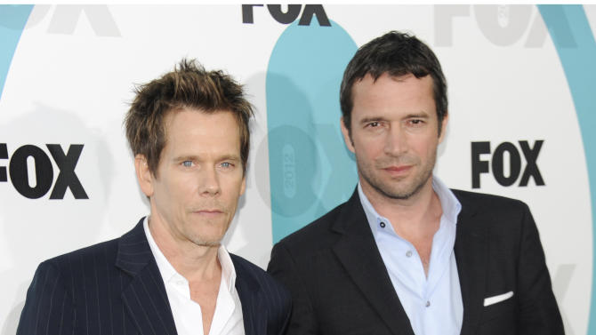 """FILE - In this May 14, 2012 file photo, """"The Following"""" cast members Kevin Bacon, left, and James Purefoy attend the FOX network upfront presentation party at Wollman Rink, in New York. Things are getting a little steamy among the stars of Fox's new thriller, """"The Following."""" The series, which debuts Jan. 21, 2013, features Kevin Bacon as an investigator pursuing a serial killer portrayed by James Purefoy. (AP Photo/Evan Agostini, File)"""