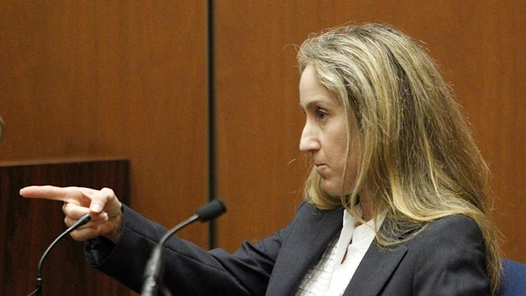 Dr. Richelle Cooper, emergency room physician testifies during the Conrad Murray involuntary manslaughter trial in downtown Los Angeles, Friday, Sept. 30, 2011. Murray has pleaded not guilty and faces four years in prison and the loss of his medical license if convicted of involuntary manslaughter in Michael Jackson's death.   (AP Photo/Al Seib, Pool)