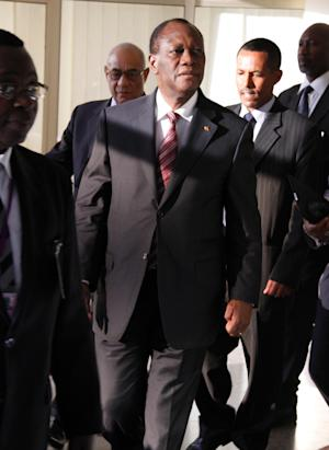 Internationally recognised Ivory Coast President Alassane Dramane Ouattara, arrives to attend the High Level Panel meeting on Ivory Coast,  at the African Union (AU) Commission headquarters in Addis Ababa, Ethiopia, Thursday March 10, 2011.  Ivory Coast's entrenched incumbent president Laurent Gbagbo imposed a no-fly order on U.N. aircraft, possibly complicating the return of the internationally recognized election winner who was attending an African Union summit Thursday in Ethiopia.(AP Photo Samson Haileyesus)