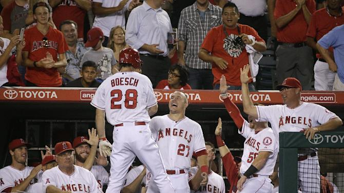 Angels clinch playoff spot, beat Mariners 8-1