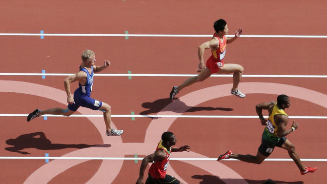 Jamaica's Yohan Blake, right, leads in a men's 100-meter heat during the athletics in the Olympic Stadium at the 2012 Summer Olympics, London, Saturday, Aug. 4, 2012. (AP Photo/Mark Duncan)