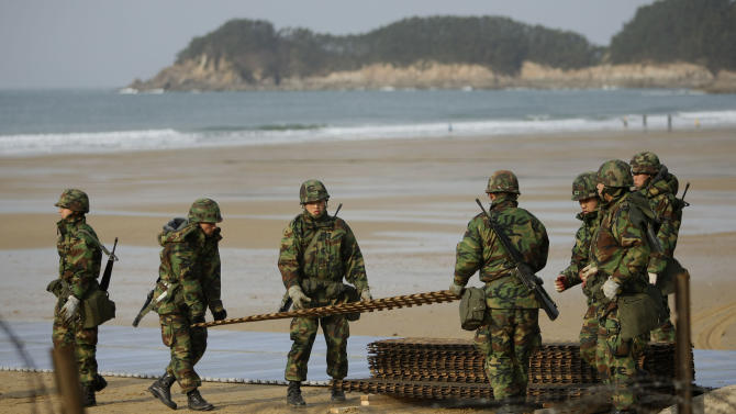 South Korean soldiers take part in a military drill on the beach in Malipo, north western South Korea, Sunday, Nov. 28, 2010. The U.S. and South Korea launched a round of war games in Korean waters sent residents and journalists on a front-line island scrambling for cover Sunday. (AP Photo/Wally Santana)