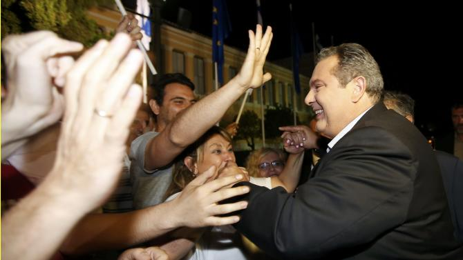 Greek Defence Minister and leader of minor coalition party Independent Greeks Kammenos meets supporters outside Zappeion in Athens