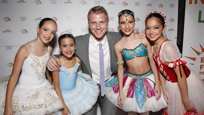 IMAGE DISTRIBUTED FOR BRIGHT FUTURE INTERNATIONAL - Sean Lowe, centre, and young ballet dancers from Panama, from left, Maria Andrea Serrano Borrero (age 10), Adriana Arias (age 10), Isabella Lucia Diaz Barochii (age 11) and Maria Antonia Liakopulos Del Castillo (age 11) attend Beyond the Ballet Presented by Bright Future International at the Beacon Theater on Wednesday, May 8th, 2013 in New York City, New York. (Photo by Todd Williamson/Invision for Bright Future International/AP Images)