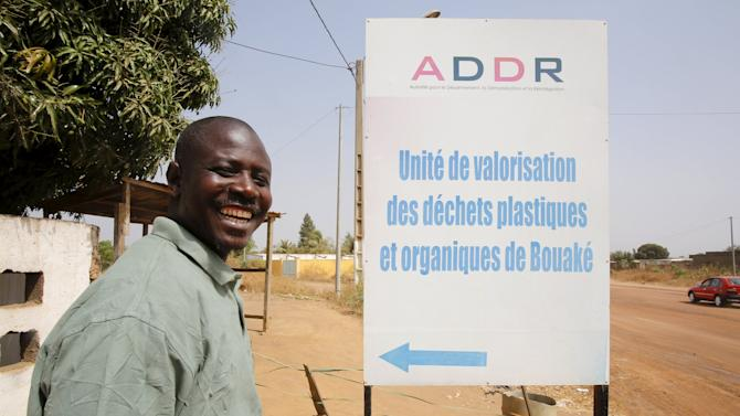 Gon Coulibaly, former rebel during Ivory Coast's civil war, smiles at a plastic recycling plant where former rebels work at as part of the Ivorian government's DDR plan for ex-fighters in Bouake