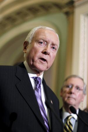 """FILE - In this Oct. 12, 2011, file photo Sen. Orrin Hatch, R-Utah, left, with Senate Minority Leader, Republican Mitch McConnell of Ky., talks to reporters about the trade bills undergoing a vote on Capitol Hill in Washington. Utah's Republican Caucuses on March 15, 2012, will give political parties and their candidates an early glimpse into the minds of conservative Republicans. """"I wouldn't be running again if it wasn't for being the Republican leader of the Finance Committee. Everyone knows that's the most important committee in the Senate, if not the most important committee in Congress,"""" Hatch said.  (AP Photo/J. Scott Applewhite, File)"""