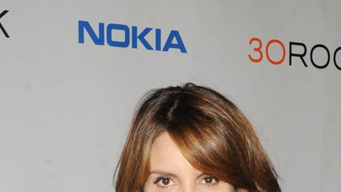 """Tina Fey attends the Nokia """"30 Rock"""" wrap party on Thursday, Dec. 20, 2012 in New York. (Photo by Scott Gries for Nokia/AP Images)"""