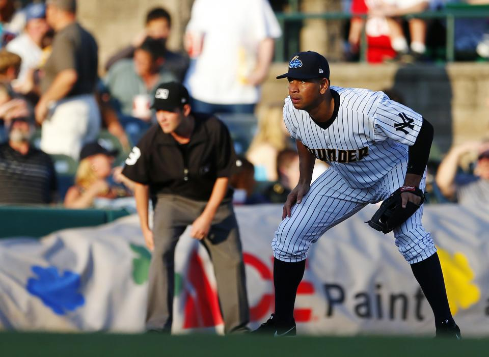New York Yankees third baseman Alex Rodriguez defends his position during the first inning of a Class AA baseball game with the Trenton Thunder against the Reading Phillies Saturday, Aug. 3, 2013, in Trenton, N.J. (AP Photo/Rich Schultz)