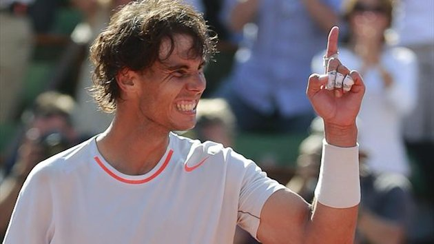 Rafael Nadal of Spain celebrates defeating Novak Djokovic of Serbia in their men's singles semi-final match during the French Open tennis tournament at the Roland Garros stadium in Paris June 7, 2013. (Reuters)