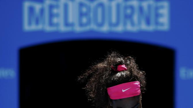 Williams of the U.S. reacts after missing a shot against Muguruza of Spain during their women's singles fourth round match at the Australian Open 2015 tennis tournament in Melbourne