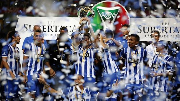 Porto's players celebrate with their trophy after defeating Vitoria Guimaraes in the Portuguese Super Cup at Aveiro's city stadium August 10, 2013 (Reuters)