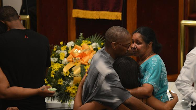 Esaw Garner is consoled by family members at the funeral service for her husband Eric Garner at Bethel Baptist Church in Brooklyn New York