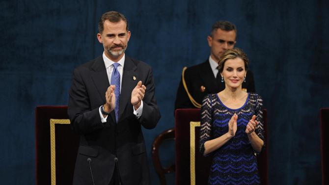 Spain's King Felipe VI and Queen Letizia clap during the ceremony for the Prince of Asturias Awards 2014 in Oviedo