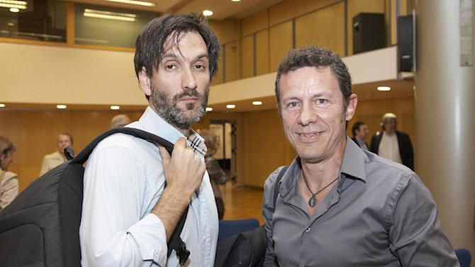 In this photo taken on May 24, 2012, Spanish reporters Javier Espinosa, right, and Ricardo Garcia Vilanova, left, pose for a photo during the ceremony of the Miguel Gil journalisms awards in Barcelona, Spain. Spanish newspaper El Mundo says one of its reporters and a freelance photographer are being held hostage in Syria by a group linked to al-Qaida. El Mundo said Tuesday that veteran reporter Javier Espinosa and photographer Ricardo Garcia Vilanova were taken captive on Sept. 16. The two were taken along with four members of the Free Syrian Army rebel group at the Tal Abyad checkpoint in the northern province of Raqqa. (AP Photo/Joan Borras)