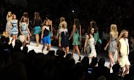 Models walk the runway at the end of the Charlotte Ronson spring 2013 show, Friday, Sept. 7, 2012, at Fashion Week in New York. (Photo by Diane Bondareff/Invision/AP)