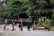 This file photo shows a Myanmar policeman patrolling a street in Sittwe, capital of Myanmar's western state of Rakhine, in June. Renewed violence between Buddhists and Muslim Rohingya has left three people dead in Rakhine, a government official said on Monday, amid growing international concern about the sectarian unrest