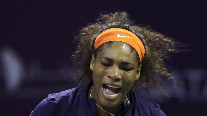 Serena Williams of the U.S. reacts during the final match against  Belarus' Victoria Azarenka, during the WTA Qatar Ladies Open tennis tournament in Doha, Qatar, Sunday, Feb. 17, 2013. (AP Photo/Osama Faisal)