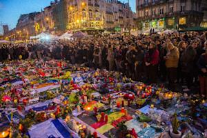 People gather at a makeshift memorial in tribute to …
