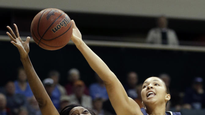 Connecticut center Kiah Stokes (41) knocks the ball away from South Florida forward Aleshia Flowers (22) during the second half of an NCAA college basketball game Saturday, March 2, 2013, in Tampa, Fla. Connecticut won the game 85-51. (AP Photo/Chris O'Meara)