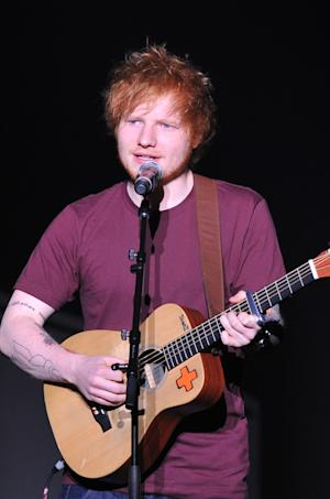 "Songwriter Ed Sheeran performs at ""Play It Forward: A Celebration of Music's Evolution and Influencers"" at the Grammy Foundation's 15th Annual Music Preservation Project, Thursday, Feb. 7, 2013, in Los Angeles. (Photo by Vince Bucci/Invision/AP)"