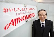Japanese spice maker Ajinomoto Co President and CEO Masatoshi Ito poses next to the company logo at the company headquarters in Tokyo
