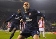 Arsenal's Thomas Vermaelen celebrates scoring against Stoke City during their English Premier League match in Stoke, northern England February 27, 2010. REUTERS/Nigel Roddis