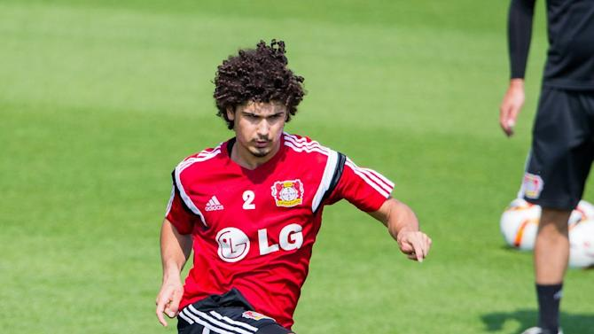 New Leverkusen player, Brazil's Andre Ramalho , plays the ball  during a practice session of the Bayer Leverkusen soccer squad in Leverkusen, Germany, Friday July 3, 2015.  ( Rolf Vennenbernd/dpa via AP)
