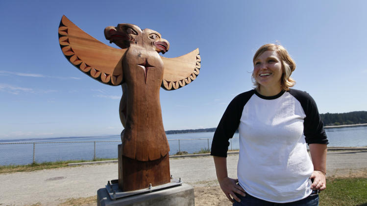Heather Purser, a Suquamish tribal member who worked to change the tribes marriage ordinance to include same-sex couples, stands near the shores of the tribe's reservation Tuesday, Aug. 2, 2011, in Suquamish, Wash. The change in tribal law came after a four-year campaign by Purser, 28, to get the American Indian Tribe in Washington state to adopt a law recognizing gay marriage. The Suquamish Tribal Council voted Monday, Aug. 1, to extend marriage rights to same-sex couples on its reservation near Seattle, making it only the second tribe in the country known to do so. (AP Photo/Elaine Thompson)